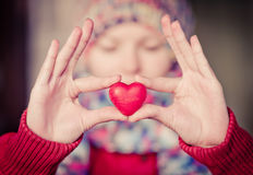 Heart shape love symbol in woman hands. With face on background Valentines Day romantic greeting people relationship concept winter holiday royalty free stock photos