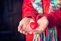 Heart shape love symbol in woman hands Valentines Day. Romantic greeting people relationship concept winter holiday Stock Image