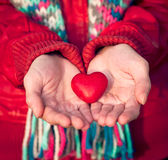 Heart shape love symbol in woman hands Valentines Day. Romantic greeting people relationship concept winter holiday royalty free stock image