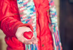 Heart shape love symbol in woman hands Valentines Day. Romantic greeting people relationship concept winter holiday Stock Images