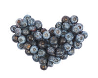 Heart shape made of bilberries isolated Stock Image