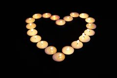 Heart shape made from candles royalty free stock photos