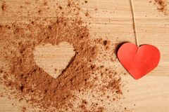 Heart shape made ??of cocoa. Close-up of the cocoa to make a form of heart Royalty Free Stock Image