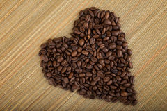 Heart shape made by coffee beans Stock Photography
