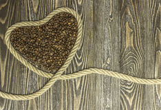 Heart shape made from coffee beans. Stock Images
