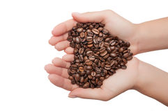 Heart shape made from coffee beans in hands. Isolated on white background Royalty Free Stock Images