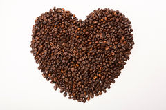 Heart shape made from coffee beans Royalty Free Stock Photography