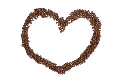 Heart shape made from coffee beans. On white background Royalty Free Stock Photography