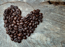 Heart shape made from coffee beans Stock Photos