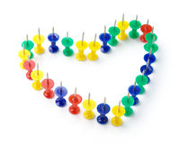 Heart shape made of color thumbtacks Stock Image