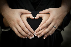 Heart Shape Made with Couple's Hands Royalty Free Stock Photo