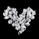 Heart shape made of crumpled paper balls. Over black background Stock Images