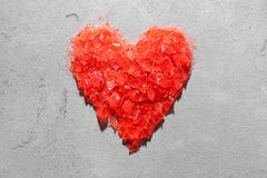 Heart shape made of crushed candy. On grey background. Relationship problems Stock Image