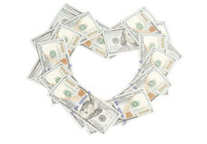 Heart shape made of dollars bills. Isolated on white Stock Photography