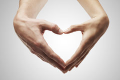 Heart shape  made of  female and male hands Stock Photography