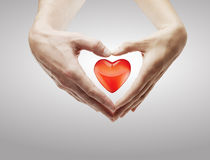 Heart shape  made of  female and male hands Royalty Free Stock Photo