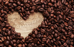 Free Heart Shape Made From Coffee Beans On Wooden Surface Stock Image - 46371751