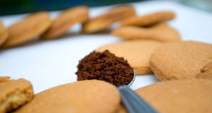 Heart shape made of gingerbread and teaspoon with black coffee Stock Photos
