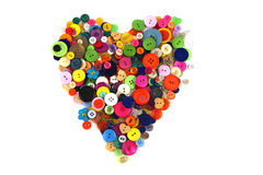 Heart shape made of haberdashery buttons Royalty Free Stock Photography