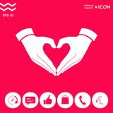 Heart shape made with hands. Signs and symbols - graphic elements for your design Stock Photos