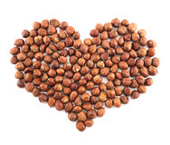 Heart shape made of hazelnuts isolated Stock Photography