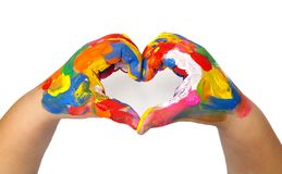 Heart shape made from kids painted hands. On white background stock photography