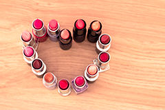 heart shape made of lipsticks/lipgloss Stock Photography