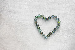 Heart shape made from marbles . valentines day concept or wedding concept. room for text. Royalty Free Stock Photos