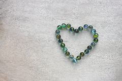 Heart shape made from marbles . valentines day concept or wedding concept. room for text. Royalty Free Stock Photography