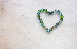 Heart shape made from marbles with vintage effect. valentines day concept or wedding concept. room for text. Stock Image