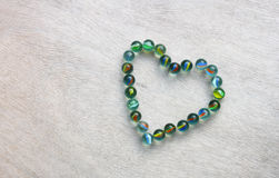 Heart shape made from marbles with vintage effect. valentines day concept or wedding concept. room for text. Royalty Free Stock Photo