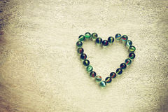 Heart shape made from marbles with vintage effect. valentines day concept or wedding concept. room for text. Stock Images