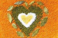 Heart shape made of mixed wheat grains, salt, green mung beans, Stock Photo