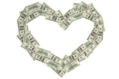Heart shape made of money Stock Photo
