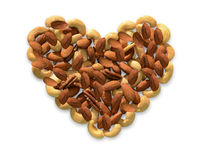 Heart shape made of nuts. Royalty Free Stock Images