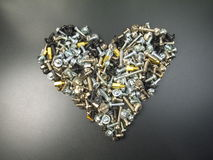 Heart shape made out of assorted screws Stock Photos