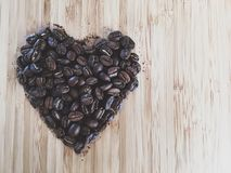 Heart shape made out of coffee beans on a table from above Stock Photo