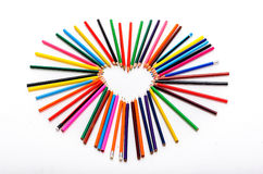 Heart shape made out of pencils on white background Royalty Free Stock Images