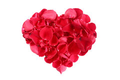 Heart shape made out of rose petals isolated on white stock photos