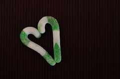 A heart shape made out of two green and white stripe candy canes Stock Images