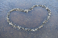 Heart shape made with pebbles Stock Photography