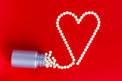 Heart shape made with pills Royalty Free Stock Image