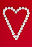 Heart shape made with pills Royalty Free Stock Photography