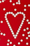 Heart shape made with pills Royalty Free Stock Photos