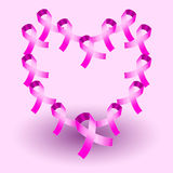 Heart shape made by pink awareness ribbons Stock Images