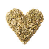 Heart shape made of pumpkin seeds Royalty Free Stock Images