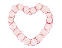 Heart shape made of radish slices. Stock Images