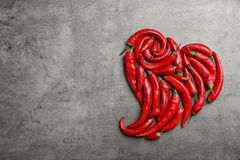 Heart shape made of red chili peppers stock image