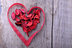 Heart shape made of red lace ribbon on a wooden Stock Photography