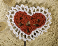 Heart shape made of red textile Stock Photos